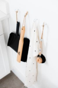 house cleaning supplies hanging on the wall