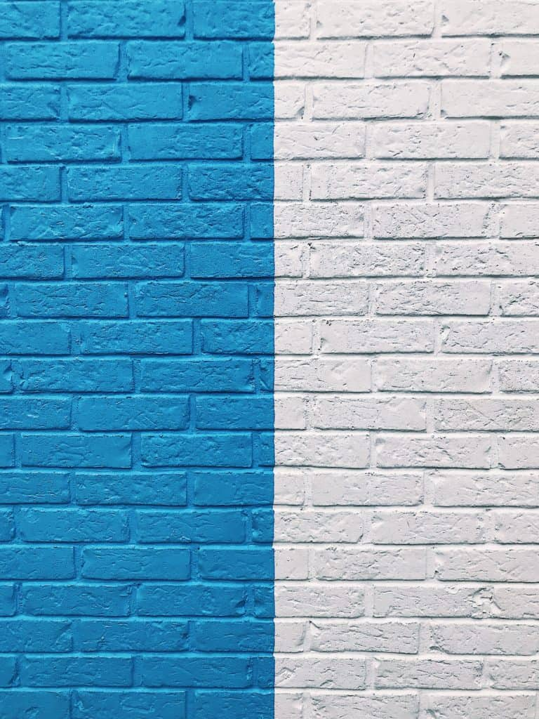 brick wall that is half blue & half white