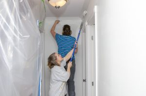 two women painting walls